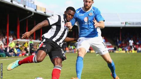 Lenell John-Lewis (L) in action for Grimsby Town