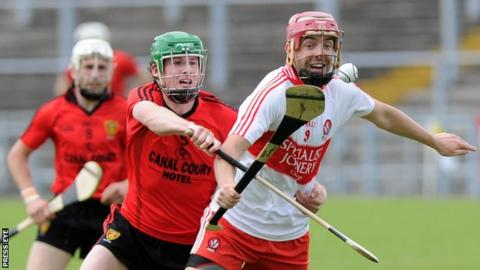 Derry's Kevin Hinphey battles with Down's Ben Toner in the Ulster semi-final in 2012