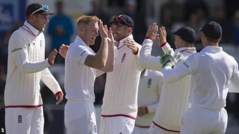 England celebrate a wicket by Ben Stokes (second left)