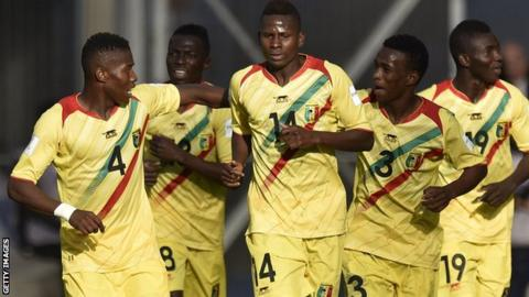 Mali players celebrate scoring against Mexico