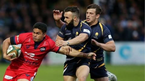 JB Bruzulier and Ryan Mills attempt to halt former Warriors winger David Lemi