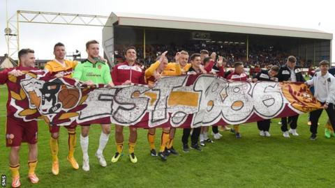 Motherwell players celebrated with fans after they secured their Scottish premiership safety