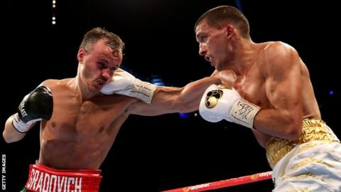 Lee Selby (right) punches Evgeny Gradovich (left)
