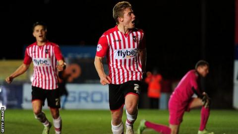 Exeter City celebrate scoring a goal