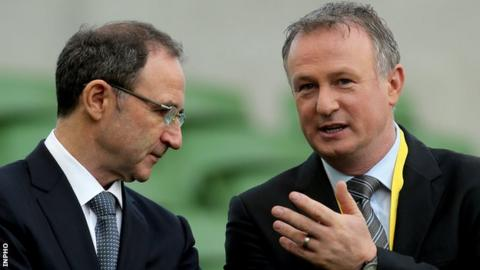 Republic manager Martin O'Neill with Northern Ireland's Michael O'Neill