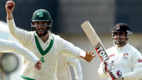 Ireland's Andrew Balbirnie celebrates taking a catch