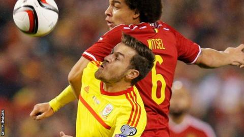 Axel Witsel of Belgium and Aaron Ramsey of Wales tussle for the ball