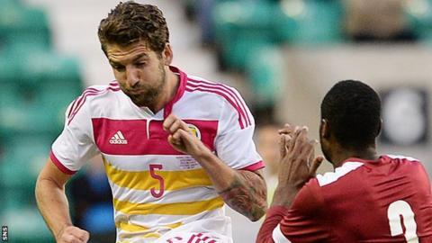 Charlie Mulgrew in action against Qatar