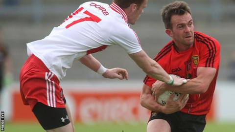 Mark Poland (right) returns to the Down team to face Derry in Sunday's Ulster SFC tie