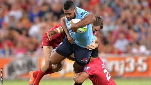 Taqele Naiyaravoro of the Waratahs charges in to the defence during the Super Rugby match against the Queensland Reds