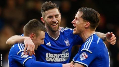 Daryl Murphy (centre) celebrates scoring for Ipswich