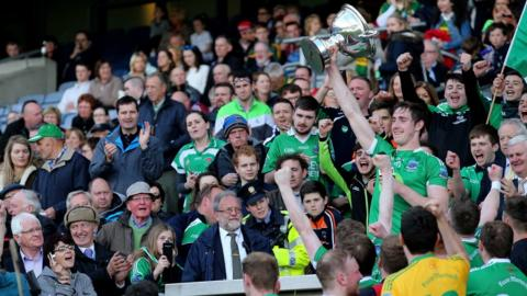 Fermanagh's John Paul McGarry lifts the Lory Meagher Cup after the Ulster county's win over Sligo at Croke Park