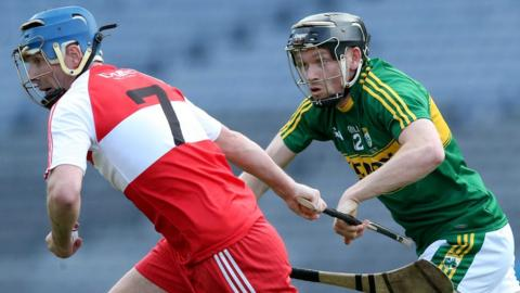 Kevin Hinphey of Derry is challenged by Kerry opponent John O'Neill during the final of the Christy Ring Cup