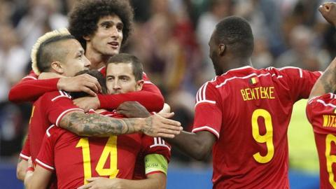 Belgium players celebrate after scoring the fourth goal against France