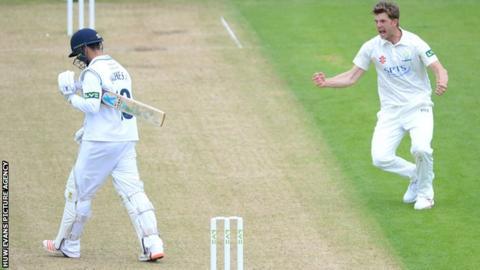 Craig Meschede of Glamorgan celebrates the wicket of Alex Hughes of Derbyshire