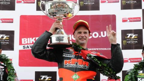 Ryan Farquhar celebrates his Supertwins victory in 2012