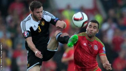 Hal Robson-Kanu of Wales challenges Nicolas Lombaerts of Belgium