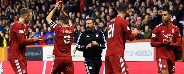 Graeme Shinnie, second left, made his final Aberdeen appearance at Pittodrie