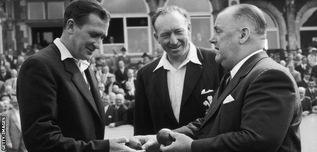 Jim Laker is presented with both of the balls he used to take 19 wickets at the end of the match