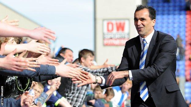 Roberto Martinez celebrates avoiding Premier League relegation with the Wigan fans in 2012
