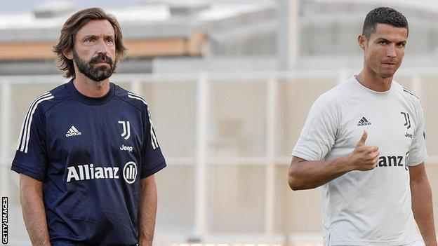 Andrea Pirlo and Cristiano Ronaldo at a training session