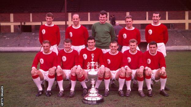 Liverpool's League Division One Champions side: Back Row (from left to right) Willie Stevenson, Ronnie Moran, Tommy Lawrence, Gordon Milne and Gerry Byrne. Front Row (from left to right) Peter Thompson, Alf Arrowsmith, Ron Yeats, Ian St John, Roger Hunt and Ian Callaghan