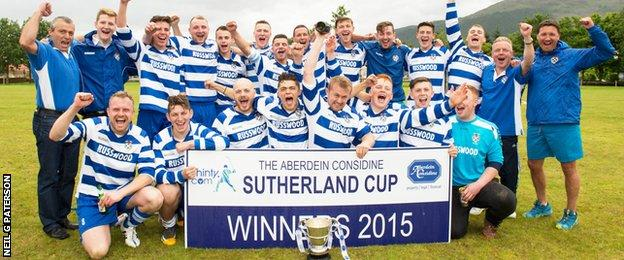 Newtonmore celebrate with the Aberdein Considine Sutherland Cup