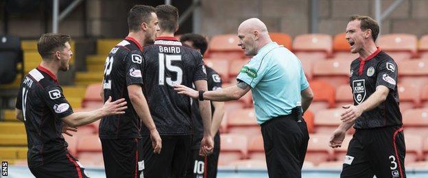 St Mirren players and referee Craig Charleston