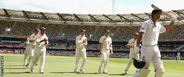 BRISBANE, AUSTRALIA - NOVEMBER 29: Alastair Cook and Jonathan Trott of England leave the ground after England declared their second innings during day five of the First Ashes Test match between Australia and England at The Gabba on November 29, 2010 in Brisbane, Australia. (Photo by Ryan Pierse/Getty Images)