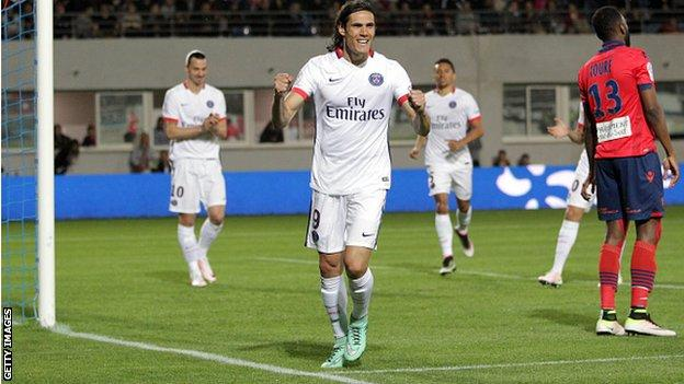 Edinson Cavani celebrates scoring for Paris St-Germain against Ajaccio