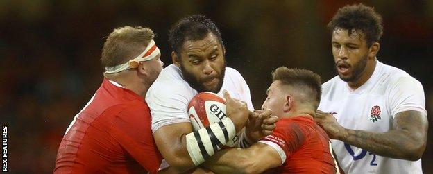 England's Billy Vunipola is stopped by the Wales defence