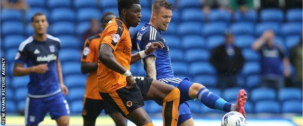 Kortney Hause of Wolves and Anthony Pilkington of Cardiff City compete for the ball