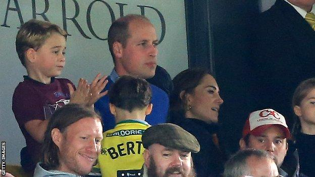 Prince William, Catherine and Prince George watch on at Carrow Road