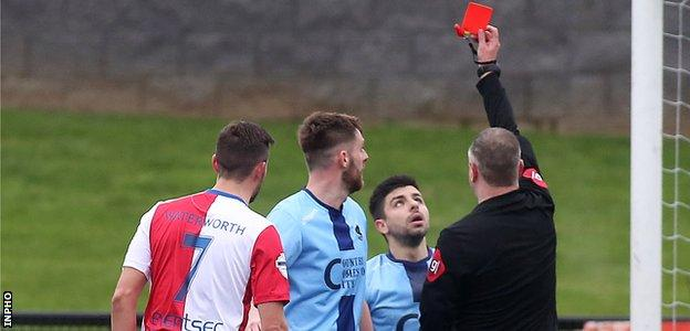Institute had defender Ryan Morrow sent off in their 3-0 defeat by Linfield