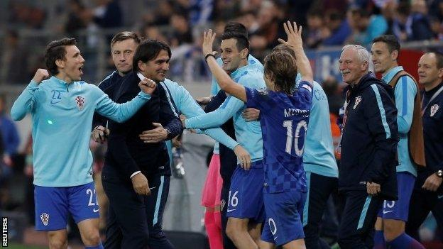 Croatia celebrate after their World Cup play-off win over Greece