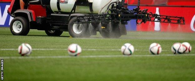 The pitch in Winnipeg is watered before a match