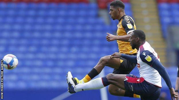 Tristan Abrahams in action against Bolton's George Taft