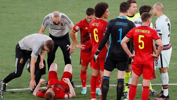 De Bruyne, seen here on the floor, was fouled before half-time but limped off moments after the re-start