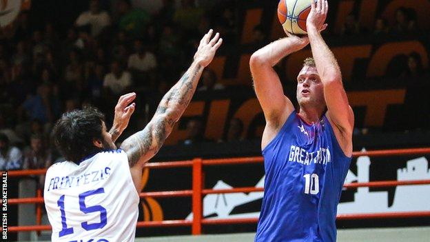 Dan Clark of Great Britain shoots for the basket