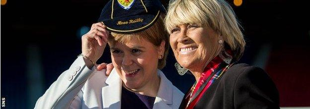Scotland's first minister, Nicola Sturgeon, presents Rose Reilly with a Scotland cap in 2019