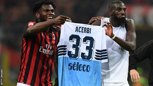 Franck Kessie and Tiemoue Bakayoko holding up Lazio defender Francesco Acerbi's shirt
