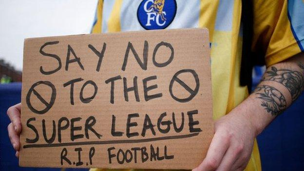 A Chelsea fan protests outside Stamford Bridge