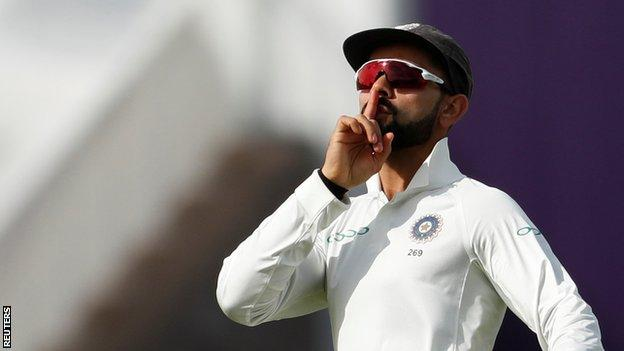 Virat Kohli celebrates running out Joe Root