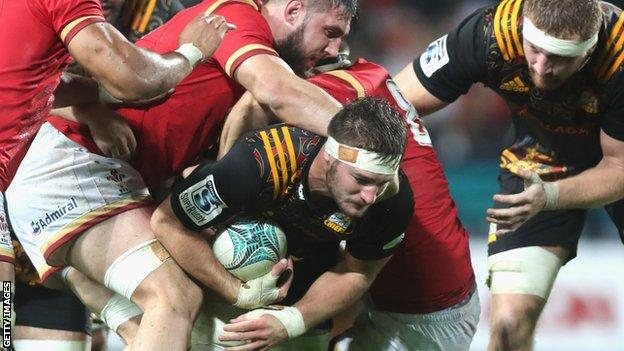 Rhys Marshall is tackled in the Hamilton game between the Chiefs and Wales in June