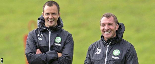Celtic assistant Chris Davies and manager Brendan Rodgers look happy in training