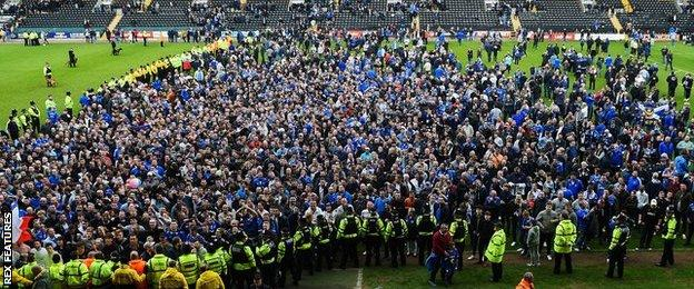 Pompey fans on pitch