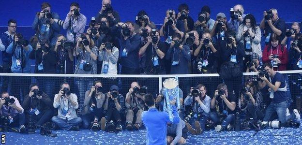 Novak Djokovic shows off the trophy