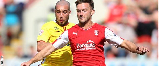 Rotherham's Lee Frecklington is challenged by Sam Carruthers