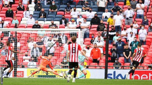 Emiliano Marcondes is currently shooting his third goal of the season home at the far post