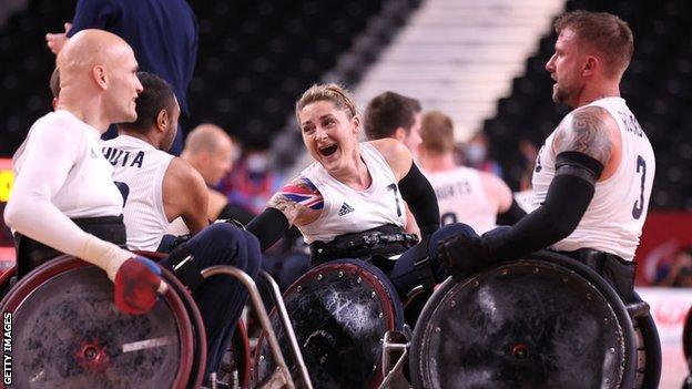 GB's Kylie Grimes celebrates with her teammates